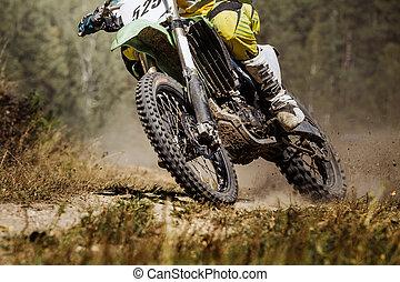 closeup of a rider on a race bike