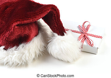 Santa Hat on white with a small wrapped gift