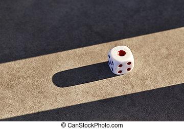 Closeup of a single white dice