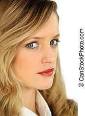 Closeup of a smart blonde woman