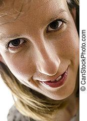 Closeup of a smiling woman portrait