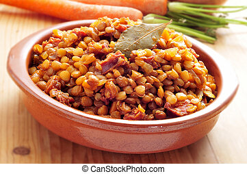 spanish lentil stew - closeup of a spanish lentil stew with ...