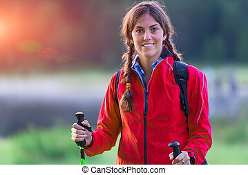 Closeup of a sporty young girl during a trek
