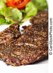 closeup of a steak with pepper