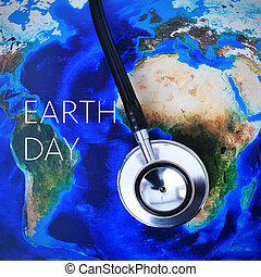 closeup of a stethoscope on a world map (furnished by NASA) and the text earth day