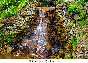 closeup of a streaming waterfall, beautiful garden architecture, Nature background