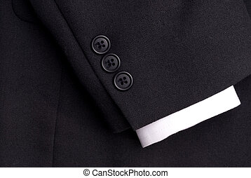 closeup of a suit sleeve with a white cuff