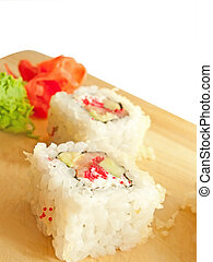 closeup of a sushi roll on the desk