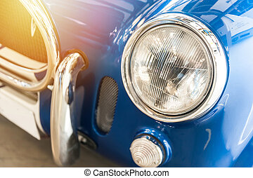 Closeup of a vintage blue sport car