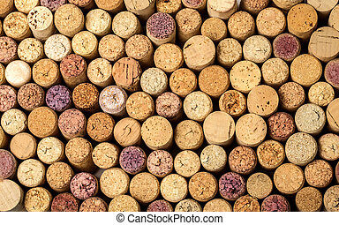 wall of used wine corks. - Closeup of a wall of used wine...