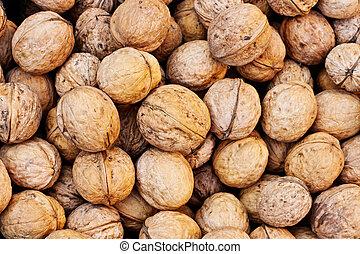 closeup of a walnuts stack texture