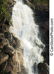 Closeup of a waterfall with rocky landscape