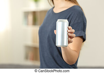 Closeup of a woman hand holding a soda drink can