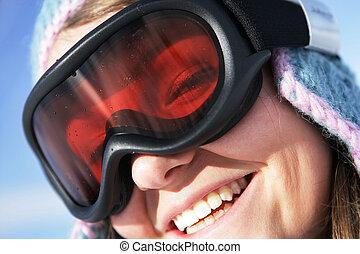 Closeup of a woman wearing a ski mask