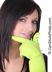 Closeup of a woman wearing household rubber gloves