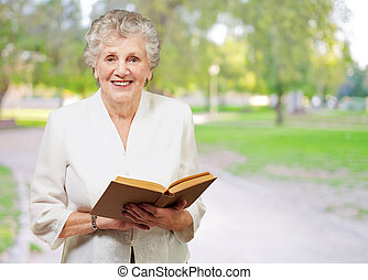 Closeup Of A Woman While Holding Book