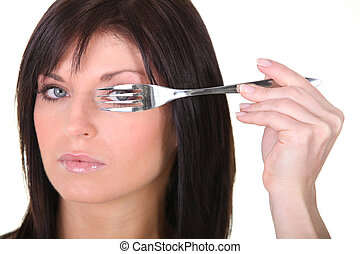 Closeup of a woman with a fork