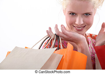 Closeup of a woman with store bags