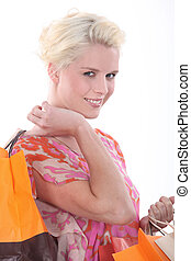 Closeup of a woman with storebags