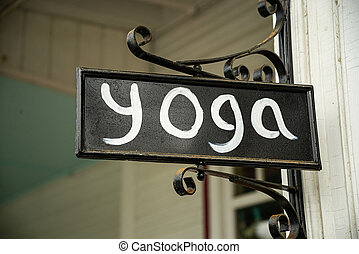 Closeup of a yoga studio sign on the the street in New England