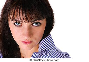 Closeup of a young beautiful woman .