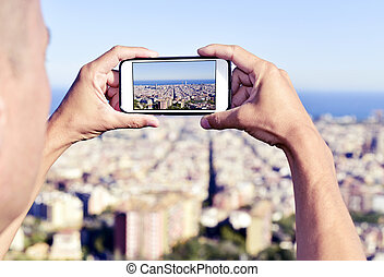 man taking a picture of Barcelona, Spain, from above