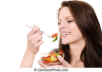 closeup of a young happy woman eating salad on white background