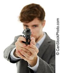 Closeup of a young man with a gun