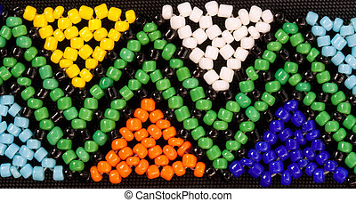 african beadwork - closeup of african beadwork in triangular...