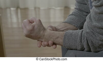 Closeup of aged old man hand affected by rheumatical ache