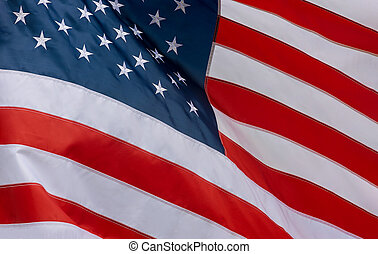 Closeup of American flag waving in the wind
