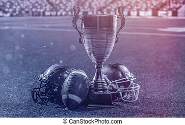 closeup of american football,helmets and trophy