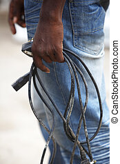 African man with defective computer cables - Closeup of an ...