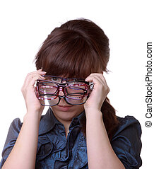 Closeup of an attractive woman holding her eyeglasses over white background