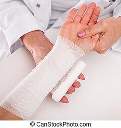 closeup of an bandaged arm