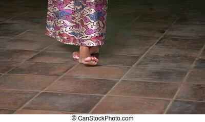 Closeup of an Indonesian dancer's feet as she performs