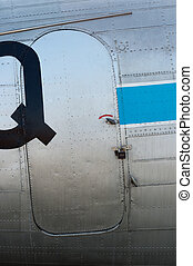 Closeup of an old airplane door