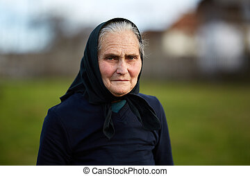 Closeup of an old woman outdoor