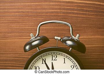 closeup of analog retro alarm clock