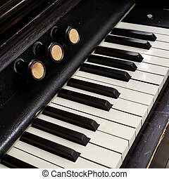 Closeup of antique piano keys and wood grain