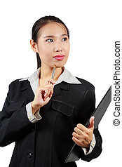 Closeup of Asian business woman in deep thought holding pen