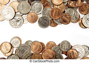 Closeup of assorted American coins on plain background