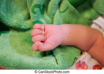 Closeup of baby hand, healthcare