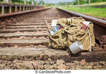 Closeup of backpack on old abandoned train station