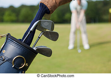 Closeup Of Bag With Golf Clubs