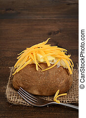closeup of baked potato with butter