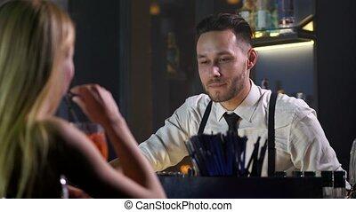 Closeup of barman communicating with woman visitor - Close...