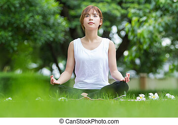 Closeup of beautiful asian women doing yoga in park