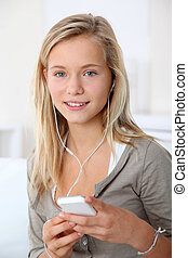 Closeup of beautiful blond girl with mobile phone