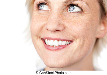 Extreme closeup of a beautiful blue eyed woman smiling against white background